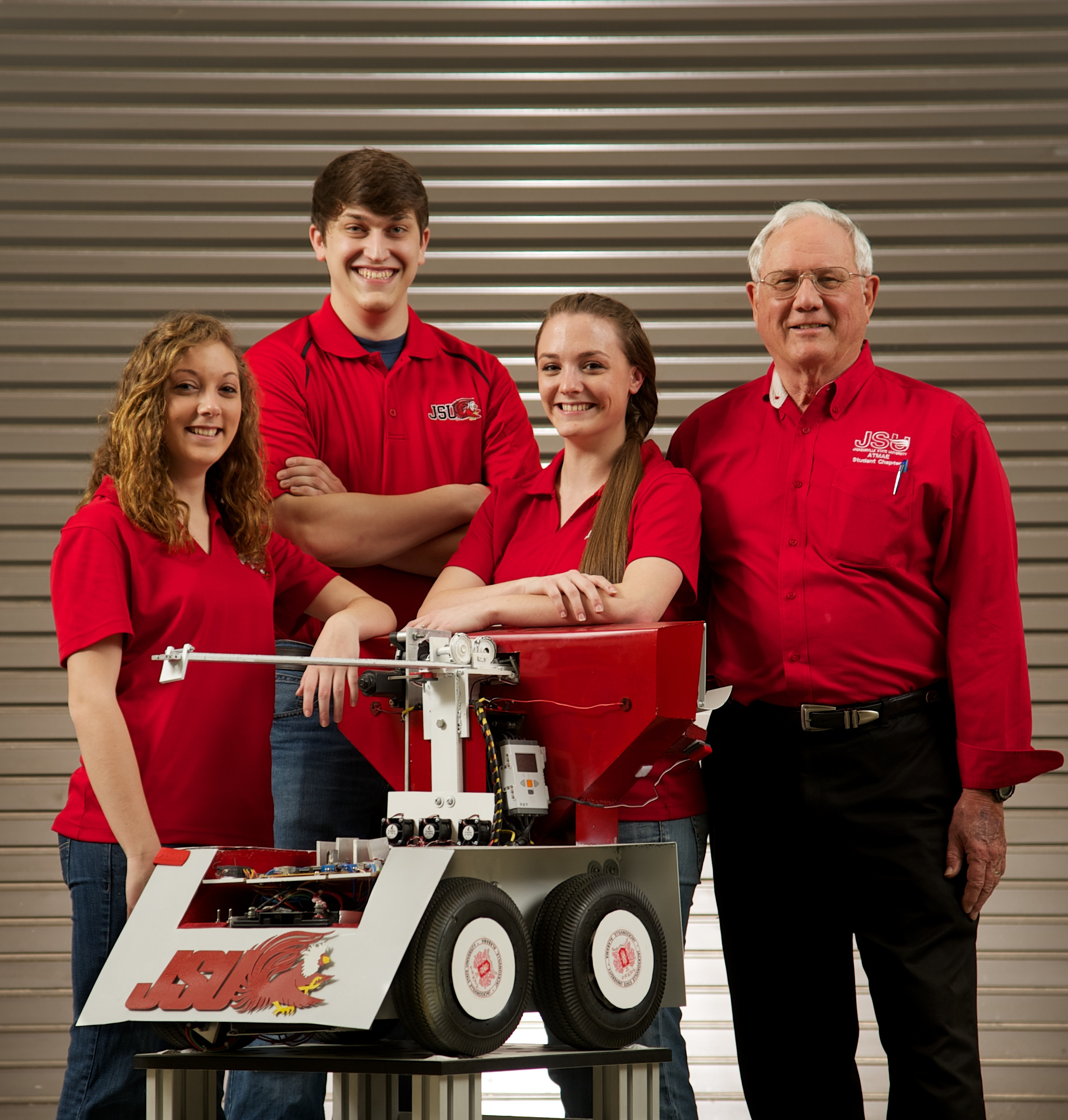 Members of the Jacksonville State University robotics team that won the President's Cup in the ATMAE competition 2 years ago are shown with their robot.  From left are, Tina Civitello, Ben Ledbetter, Jessica Civitello and instructor Phillip Dean.