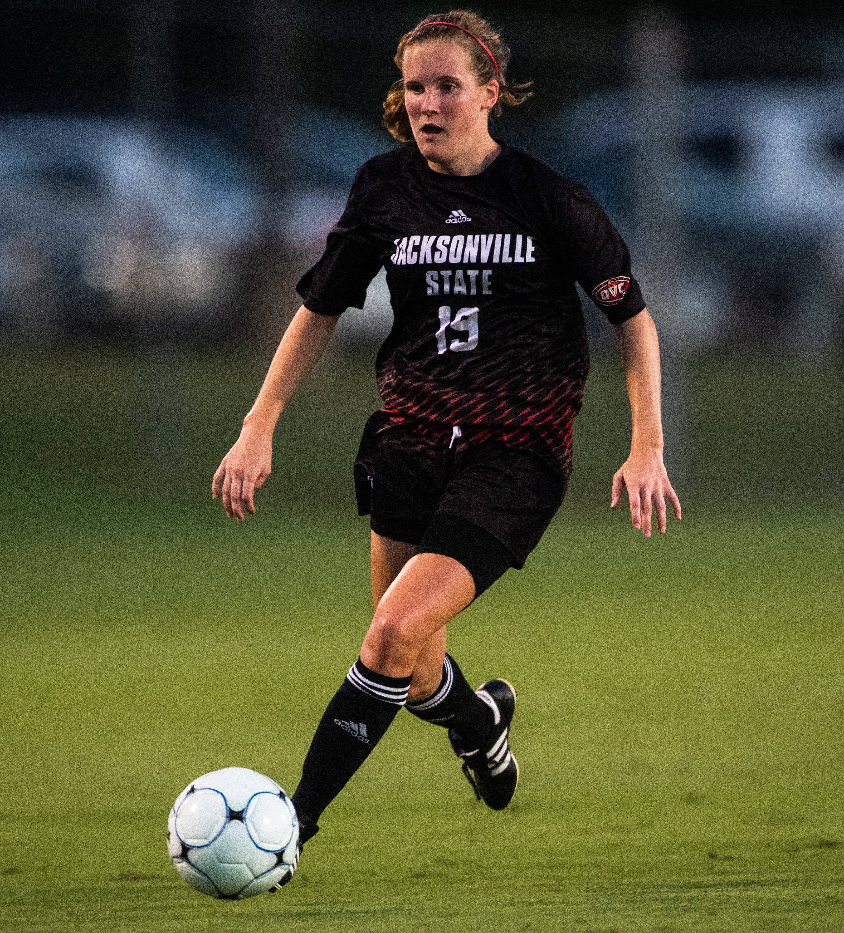 Maddy Meadows dribbles the soccer ball down the field during a game.