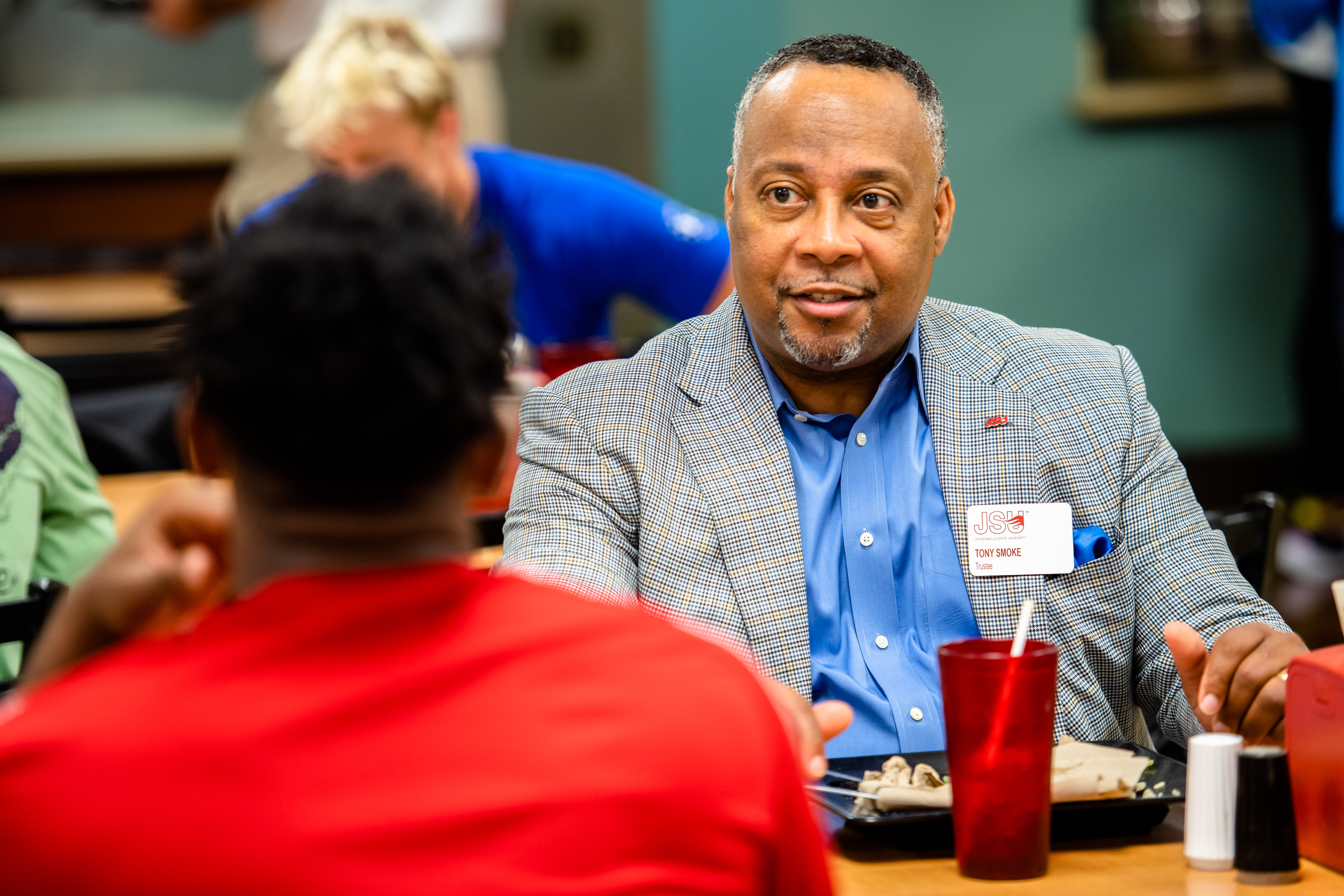 Tony Smoke, pictured right, a JSU trustee, gathered with other trustees in the Jack Hopper Dining Hall to meet with students. (Grace Cockrell/JSU)