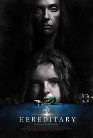 Movie poster for the film Hereditary. Shows two figures , one a young child.
