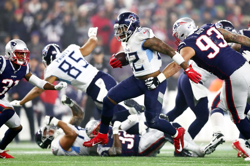 Titans running back Derrick Henry had 34 carries for 182 yards and a touchdown to lead his team to victory. (Adam Glanzman/Getty Images)