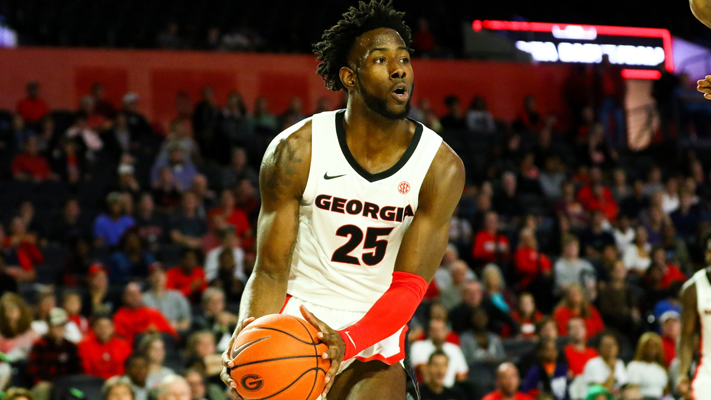 Amanze Ngumezi poised in triple threat position in a game at the University of Georgia where he previously attended and played collegiate basketball. (Courtesy of JSU)