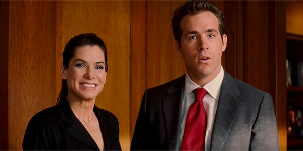 """Sandra Bullock, left, and Ryan Reynolds, right, star in the 2009 romantic comedy film """"The Proposal"""". (Courtesy of Cinema Blend)"""
