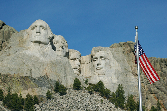 Mount Rushmore, pictured, is a massive sculpture located in South Dakota that depicts U.S. Presidents George Washington, Thomas Jefferson, Theodore Roosevelt and Abraham Lincoln. (Courtesy of the National Park Service)