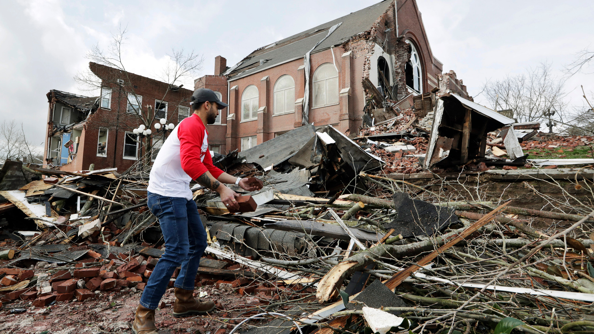 Man helps to clean up rubble at the East End United Methodist Church after it was heavily damaged by storms Tuesday, March 3, 2020, in Nashville, Tenn. (Mark Humphrey/AP)