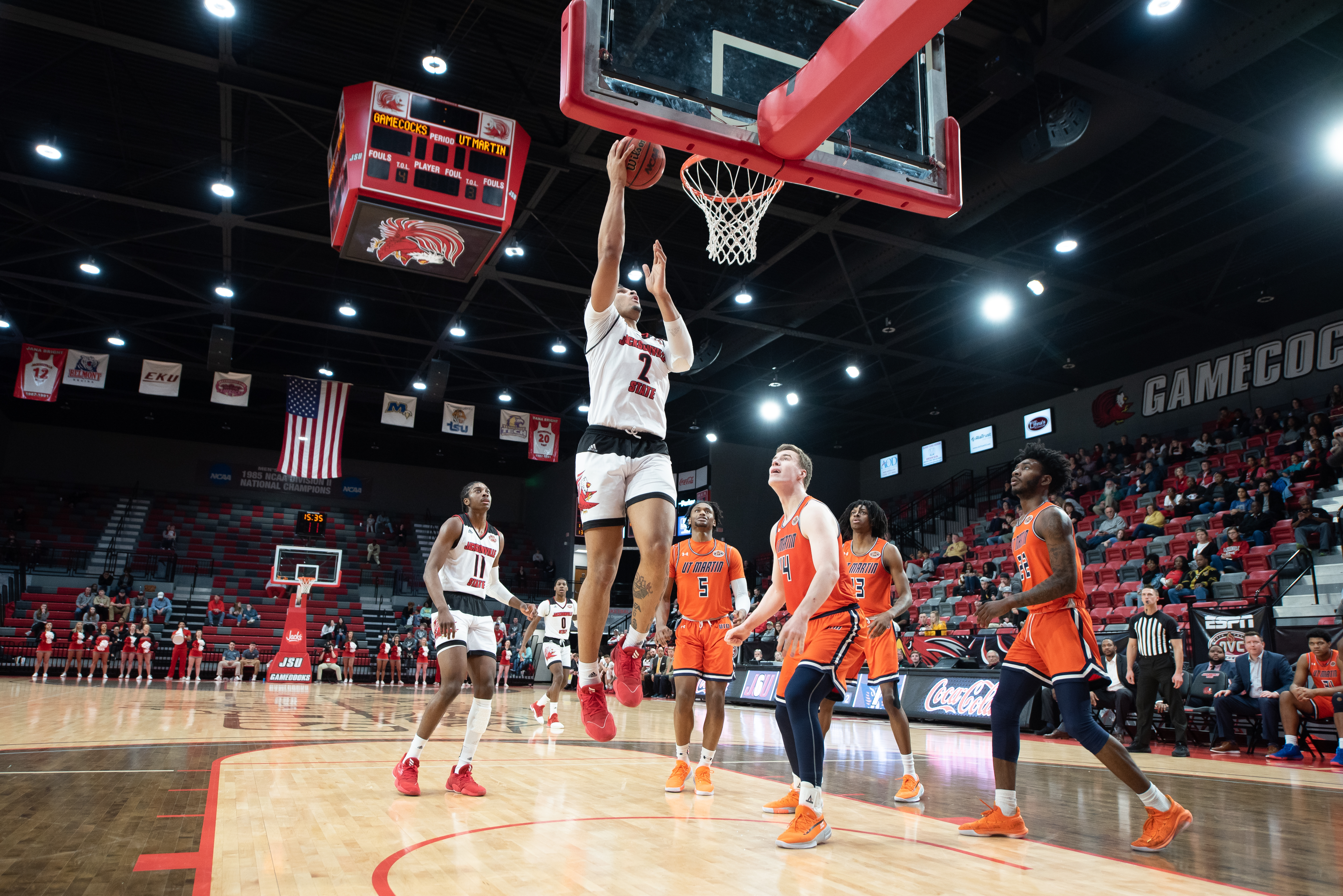 All-OVC Second team member Jacara Cross goes in for a lay up in a game against UT Martin while All-OVC Newcomer Kayne Henry watches his teammate go in for the basket. (Courtesy of JSU)
