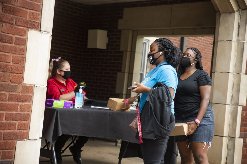 Volunteers handing out tacos and treats to students in the quad Thursday.