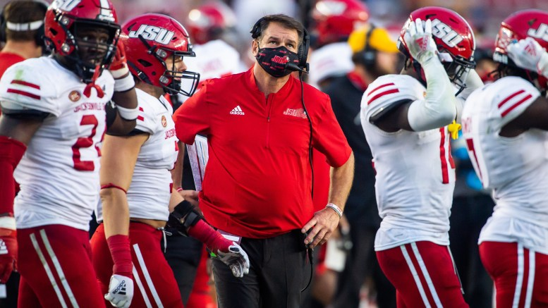 """JSU football head coach John Grass stands on the sidelines during the Gamecock's matchup against Florida State on Oct. 3. Grass tested positive for COVID-19 on Oct. 15, and after only experiencing """"mild symptoms"""" he was cleared to attend the Florida International game on Oct. 23. (Matt Reynolds/JSU)"""