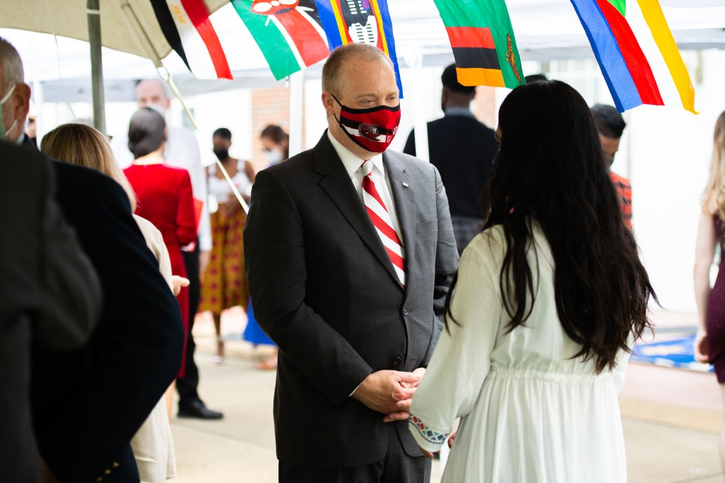 JSU President Don Killingsworth speaking with a member of International House at United Nations Day Tea 2020 on Sunday. (Matt Reynolds/JSU)