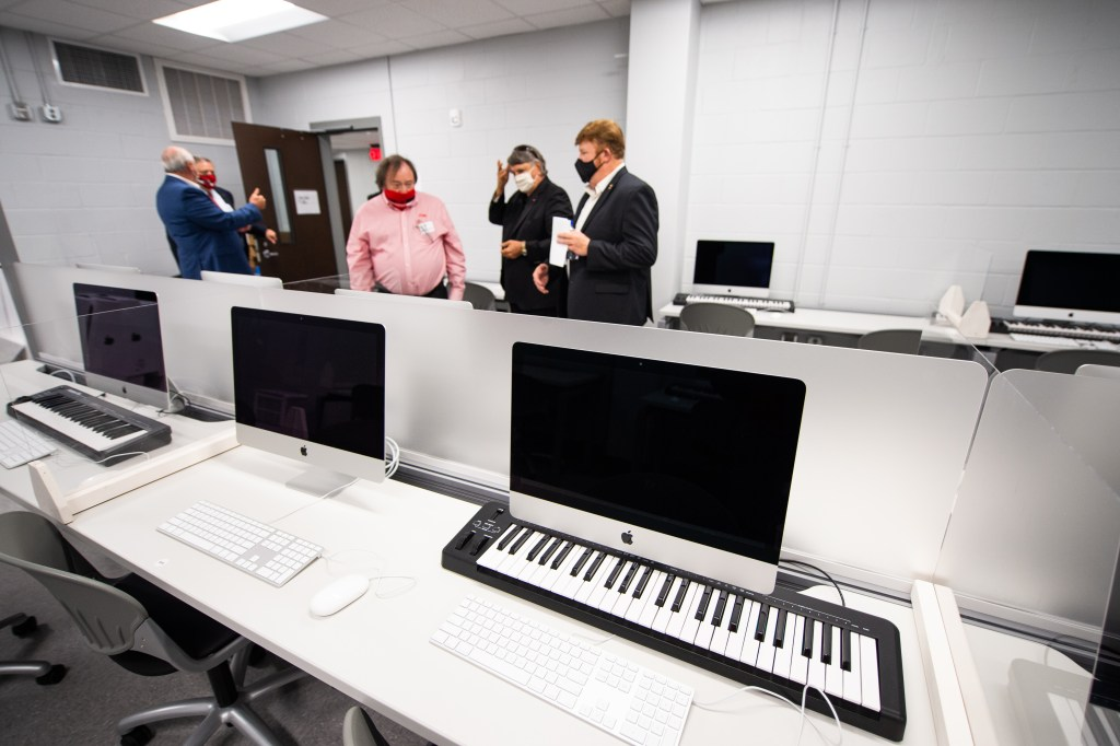 JSU Director of Bands Ken Bodiford gives members of the Board of Trustees a tour of the newly-renovated Mason Hall on Monday. (Matt Reynolds/JSU)