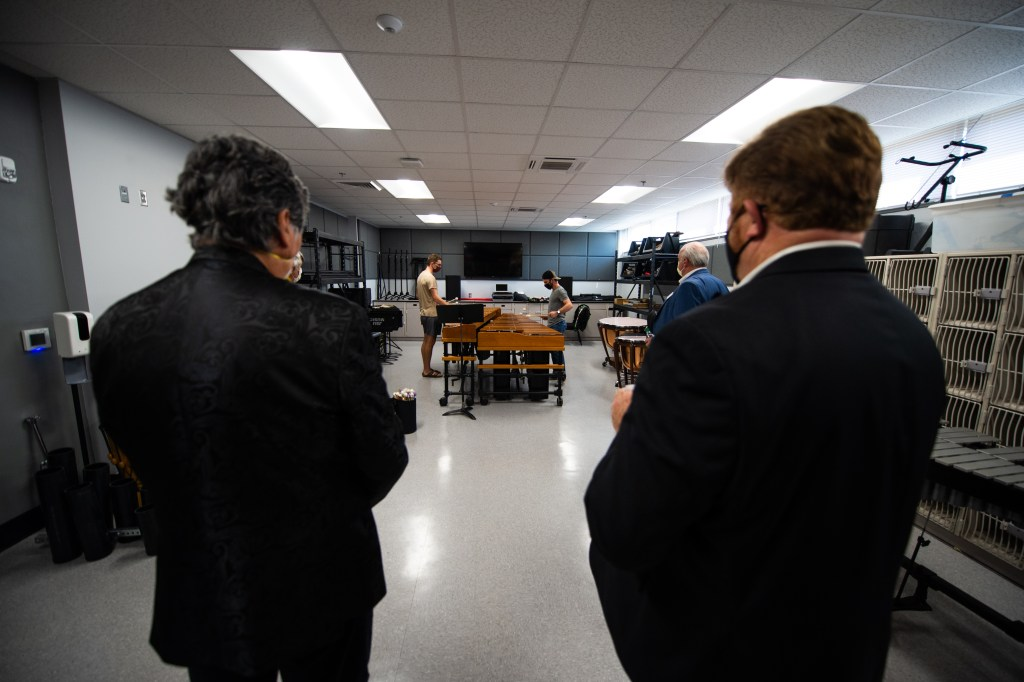Students play musical instruments in the practice rooms as JSU Director of Bands Ken Bodiford leads the Board of Trustees on a tour of Mason Hall on Monday. (Matt Reynolds/JSU)