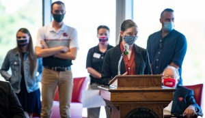 JSU student Abigail Read, pictured at podium, speaks at the Board of Trustees meeting on Tuesday on the Vital Skin invention created by her, Zach Galbreath, Avery Lowe, Will Milner and Kyra Watral. The invention competed in a Biodesign challenge course. (Matt Reynolds/JSU)