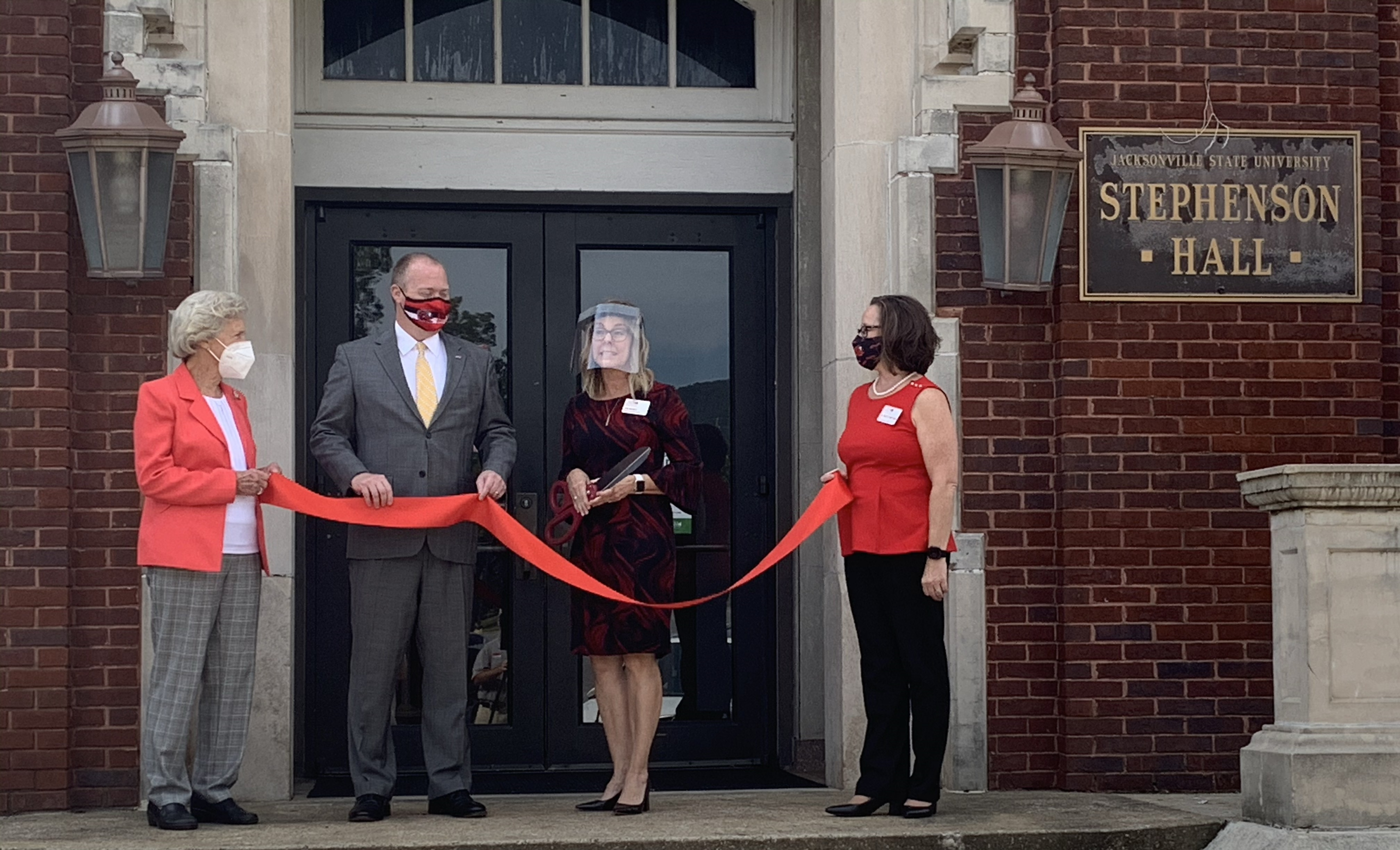 (From left to right): Professor Emeritus Margaret Hope, JSU President Don Killingsworth, Head of the Department of Kinesiology Gina Mabrey and Dean of the School of Health Professions and Wellness Tracey Matthews participate in a ribbon-cutting ceremony for newly-renovated Stephenson Hall. (Coley Birchfield/The Chanticleer)