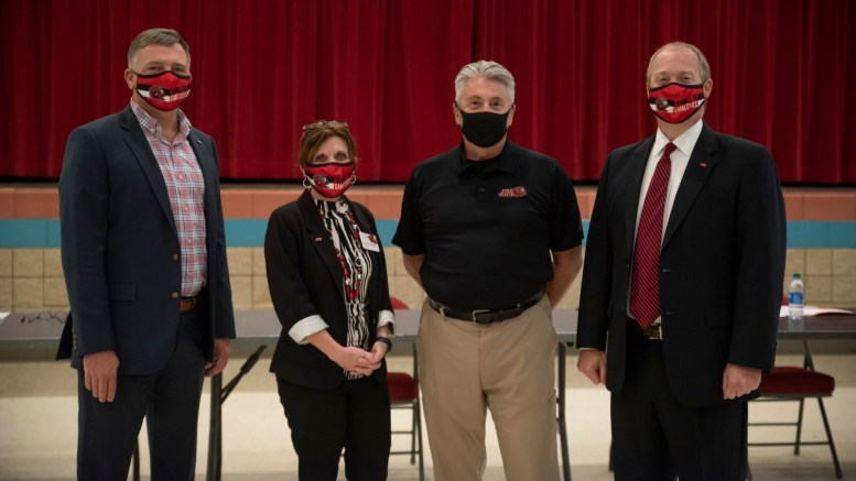 (Left to right): Vice President of Student Affairs Terry Casey, Provost Christie Shelton, Chief of Program Operations Jeff Ryan and President Don Killingsworth pose for a photo at the university's town hall event on Wednesday. (Ashley Phillips/The Chanticleer)