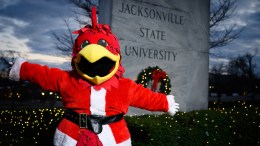 Cocky poses for a photo in front of the decorated JSU campus on Dec. 7, 2019. (Grace Cockrell/JSU)