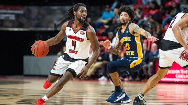 Former Guard Ty Hudson (4) carries the ball against Murray State, who narrowly defeated the Gamecocks 72-68 in Pete Mathews Coliseum on Jan. 9, 2020. (Matt Reynolds/JSU)