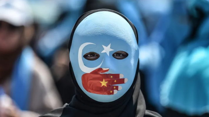 """Natalie Walls writes that human rights abuses in China against the Muslim Uighur community must be met with """"naming and shaming"""" in the United Nations. (Ozan Kose/AFP)"""