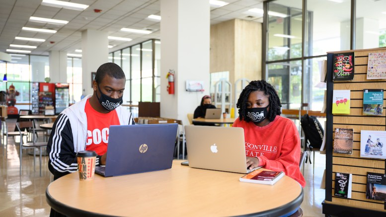 Students study on their laptops in Houston Cole Library. (Grace Cockrell/JSU)