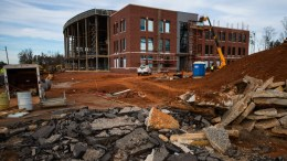 Construction workers are currently installing exterior wall sheathing and finishes, interior finishes, framing, windows, roofing and building systems including HVAC, electrical and plumbing. The university is aiming for the building to open by Aug. 2021. (Matt Reynolds/JSU)