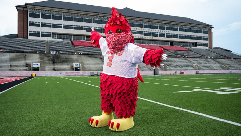 Cocky poses masked for a photo at Burgess Snow Field. The university announced on Friday that it would move to COVID-19 response level one. (Matt Reynolds/JSU)