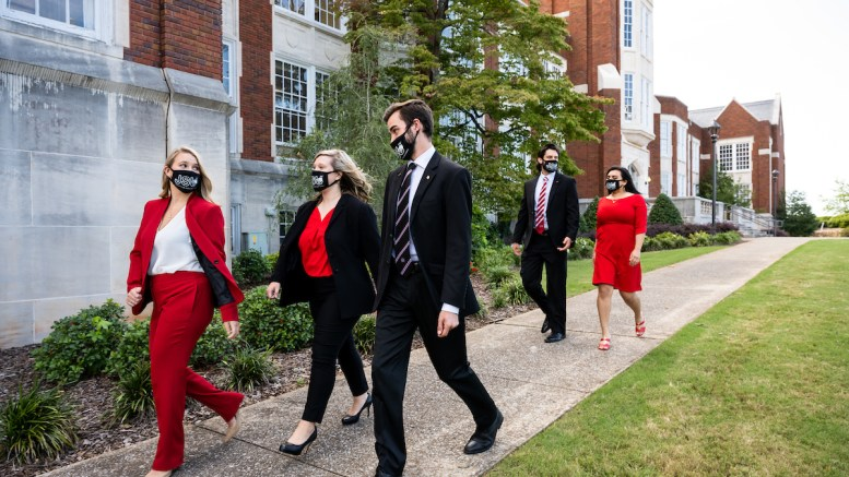 (From left to right): 2020-2021 SGA executives Brooke Robinson, Auburn McKee, Jerod Sharp, Scout Spears and Cindy Danini walk in front of Angle Hall. Candidates vying for election to the Student Government Association are counting on the student vote on April 13. Voting will take place from 12:01 a.m. to 4 p.m. on myJSU. (Matt Reynolds/JSU)